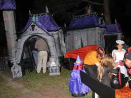 Spooky tent and children with candy