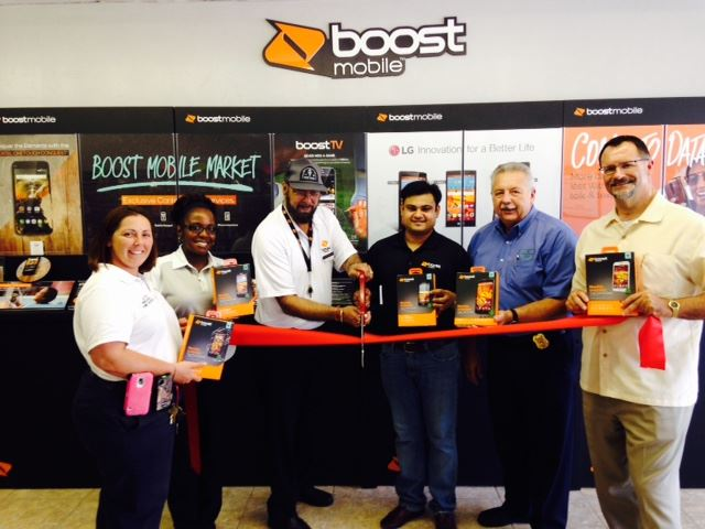 Group standing and ready to cut ribbon for Boost Mobile